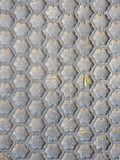 Black honeycomb pattern floor matt stock images