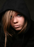 Black hood. Portrait of the young girl in a black hood Stock Photos