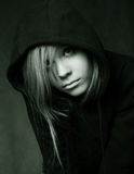 Black hood. Portrait of the young girl in a black hood Royalty Free Stock Image