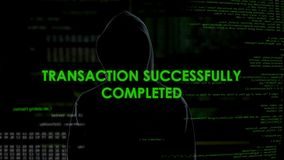 Black hood man making online transaction, money laundering, financial fraud
