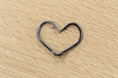 The black hooks placed heart symbols. Royalty Free Stock Photography