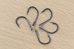 The black hooks placed on wood. Stock Photography