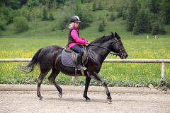Black horse and girl Royalty Free Stock Photos