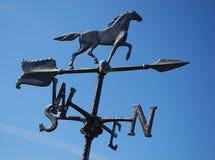 Black horse weather vane blue sky stock images