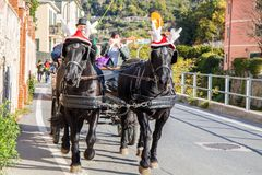 Black horses with carriage with funny Christmas hats, Italy stock photography