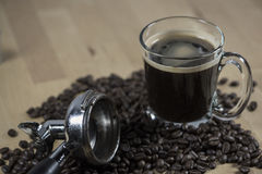 Black hot coffee with coffee bean. Royalty Free Stock Photography