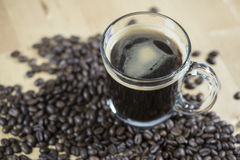 Black hot coffee with coffee bean. Stock Photos