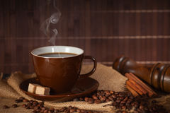 Black hot coffee cup with sugar and cinnamon royalty free stock photos
