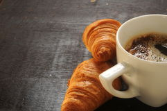 Black hot coffee with two croissants bake pieces Stock Photography