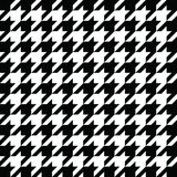 Black houndstooth pattern vector. Classical checkered textile design. Royalty Free Stock Photo