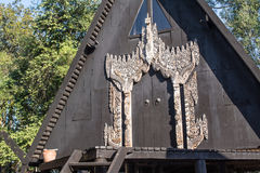Black house. Lanna art all painted in black. In each house is adorned with carved wooden patterns Stock Photos