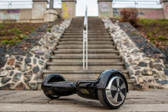 Black hoverboard against the background of stairs Royalty Free Stock Photos