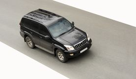 Black huge suv car drives fast Stock Photography