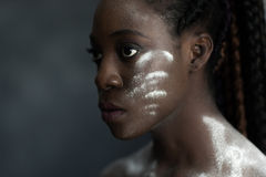 Black human skin with wite stripes of powder Royalty Free Stock Image