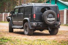 Black Hummer H2 rear view Royalty Free Stock Image