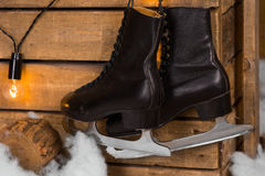 Black Ice Skates Hanging on the Wall Stock Photography