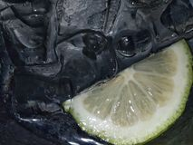 Black ice and yellow lemon royalty free stock photo