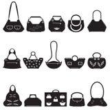 Black icons female bags. Black vector icons female bags. Original handbags Royalty Free Stock Images