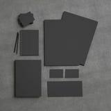 Black identity elements on textile background Stock Images