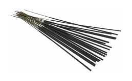 Black incense. A group of black incense fanned out on a white background Royalty Free Stock Image