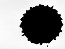 Black ink blot on white paper. Sheet Stock Photo