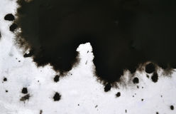 Black Ink Conveyed Over White Close-up Paper. Stock Photo