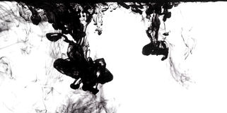 Black ink dissolving in water Royalty Free Stock Photography