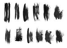 Black ink grunge brush set strokes on white background. stock photography