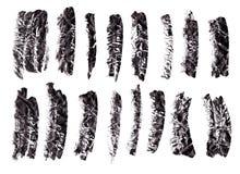 Black ink grunge brush set strokes on white background. stock images