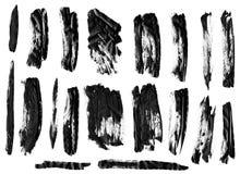 Black ink grunge brush set strokes on white background. stock image