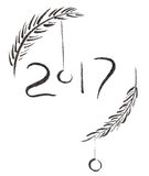 2017 black ink sign with spruce branches and jingle balls, hand drawn brush calligraphy.  Royalty Free Stock Photos