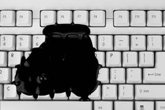 Black ink splash on keyboard Royalty Free Stock Photo