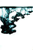 Black ink. In water. Ink dropped in water. Ink photographed in motion. Food coloring dropped in water Stock Image