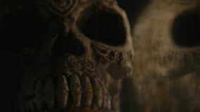 Black ink in water with Skull on black background.  stock footage