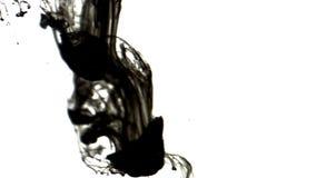 Black inks in water 4K. A drop of black ink in water in slow motion stock video