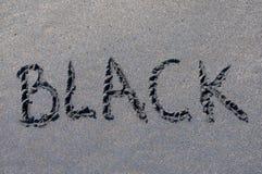 Black inscription drawn on black sand. Black inscription drawn on a black sand beach near Canggu, Bali - Indonesia royalty free stock image