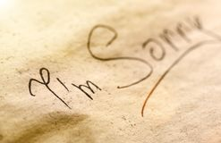 Black inscription on piece of paper Royalty Free Stock Photo