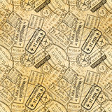 Black International travel visa rubber stamps imprints on old paper, seamless pattern. Many black International travel visa rubber stamps imprints on old paper Stock Photography