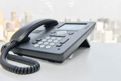 Black IP Phone on the white table Stock Images