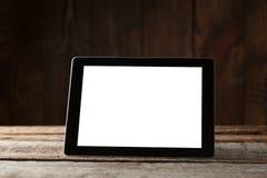 Black ipad on old wood table. Background stock image
