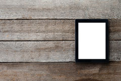 Black ipad on old wood table. Texture royalty free stock images