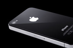 Black iPhone 4s on black background. Black iPhone 4s isolated on black Royalty Free Stock Photography