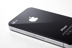 Black iPhone 4s on white background Stock Photos