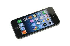 Black iPhone 5. Isolated in white background Stock Image