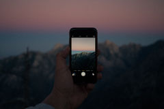Black Iphone Took a Picture of the Mountains Royalty Free Stock Photo