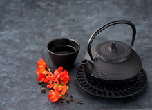 Black iron asian style teapot and cup green tea Royalty Free Stock Image