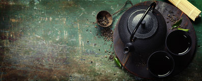 Black iron asian tea set stock photo