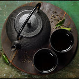 Black iron asian tea set Royalty Free Stock Images
