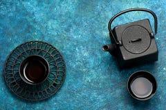 Black iron asian tea set in vintage style Stock Photography