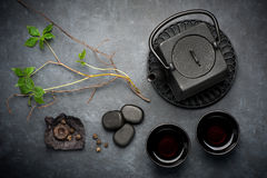 Black iron asian tea set in vintage style Stock Photos